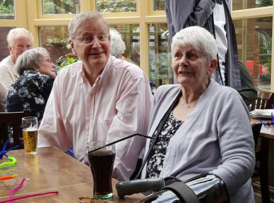 Picture of John and Eileen at his 80th birthday party