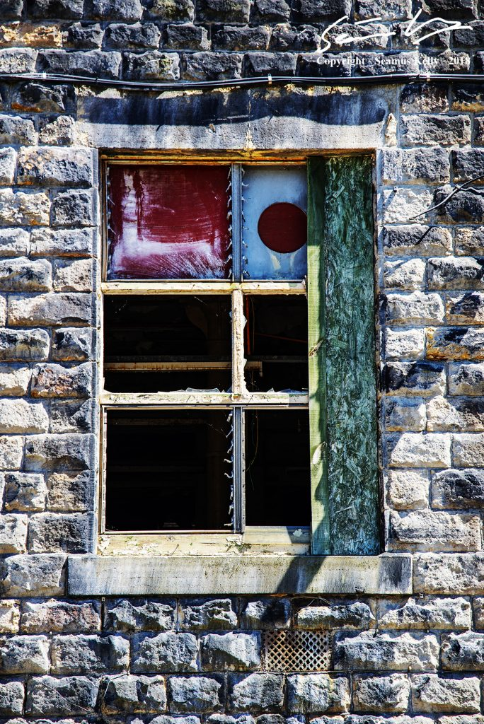 Photo of a window in a derelict mill on the Rochdale canal